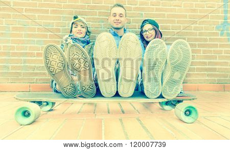 Urban Stylish Trendy Young Teenage People With Legs On Longboard - Happy Skaters Having Fun Together
