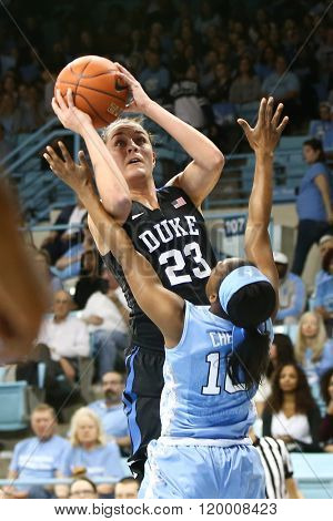 CHAPEL HILL, NC-FEB 28: Duke Blue Devils guard Rebecca Greenwell (23) shoots as University of North Carolina Tar Heels guard Jamie Cherry (10) defends on February 28, 2016 at Carmichael Arena.