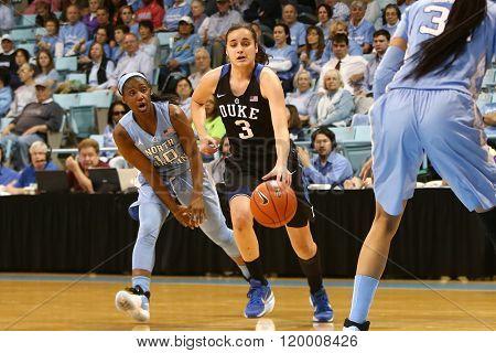 CHAPEL HILL, NC-FEB 28: Duke Blue Devils guard Angela Salvadores (3) dribbles as University of North Carolina Tar Heels guard Jamie Cherry (10) gives chase on February 28, 2016 at Carmichael Arena.