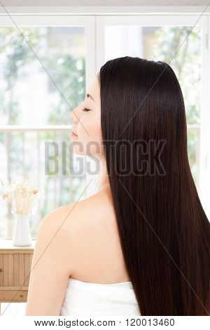 Asian woman showing perfect skin and long hair