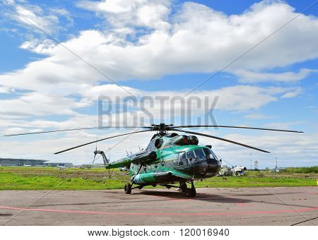 The Mil Mi-8 Helicopter Of Spark Avia Airline Company At The Parking  In Pulkovo Airport