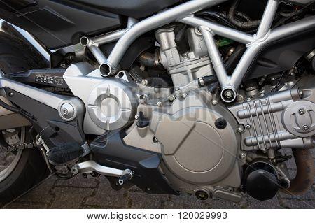 Shiny Chrome Motorcycle Engine Block On The Street