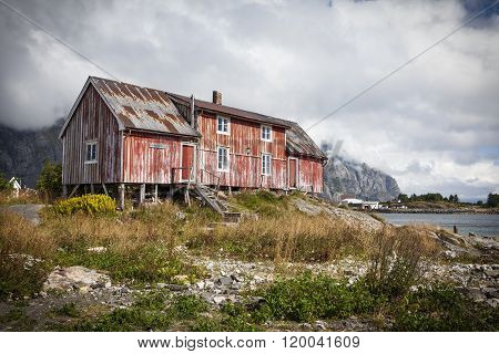 Picture of an old red fishing house in Henningsvaer at Lofoten islands