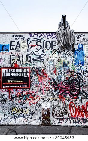 BERLIN, GERMANY-October 15, 2014: Berlin Wall was a barrier constructed starting on 13 August 1961. East Side Gallery is an international memorial for freedom. October 15, 2014 in Berlin