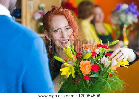 Flower Shop Owner Working On Bouquet