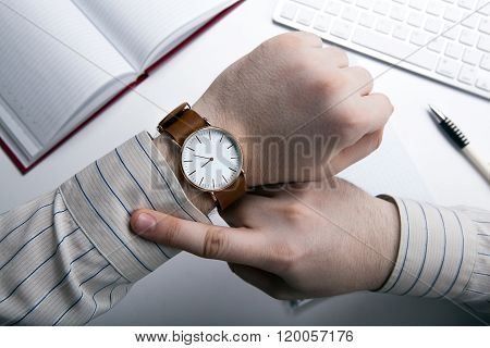 Workplace Businessman Looks At The Clock