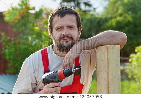 Handyman Working In The Yard