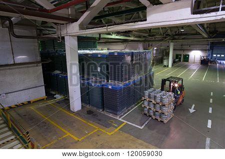 Warehouse Premises Beer And Other Alcoholic Beverages. Forklift Pallets