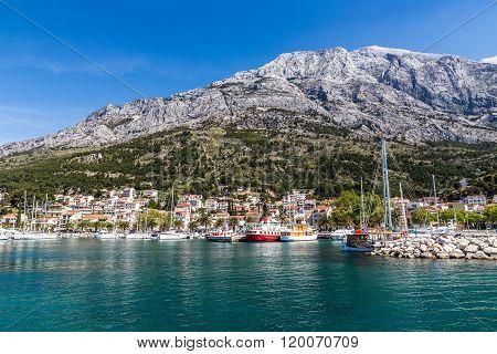 Harbor With City And Biokovo Mountain In The Background - Baska Voda Makarska Dalmatia Croatia