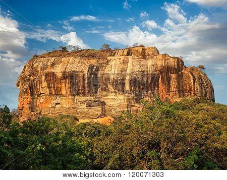 Sigiriya rock - famous Sri Lankan tourist landmark on sunset, Sri Lanka