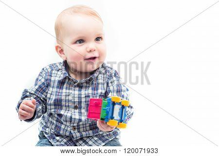 Baby Boy Holding Toy Car