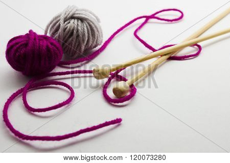 Knitting Needles And Balls Of Wool Yarn
