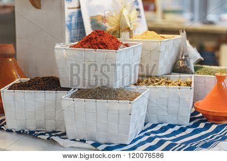 spices and seasonings in white baskets