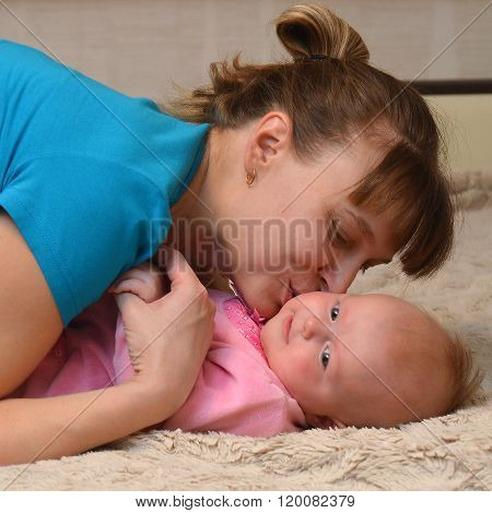 Mother And Baby Kissing And Hugging