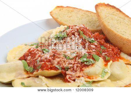 Ravioli pasta with tomato sauce and garlic bread