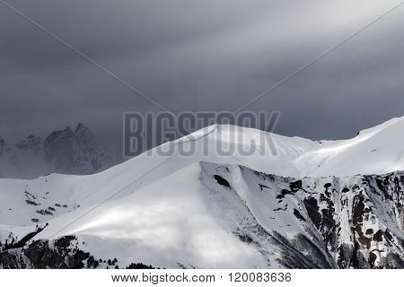 Sunlight Mountains With Snow Cornice And Trace From Avalanche Before Blizzard