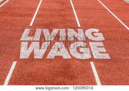 Living Wage written on running track