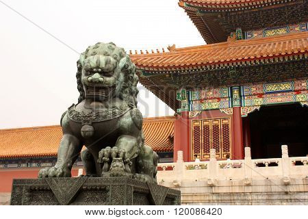 Bronze lion is guarding Forbidden City