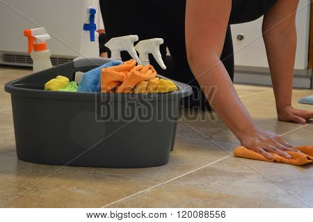 Woman spring cleaning a kitchen floor
