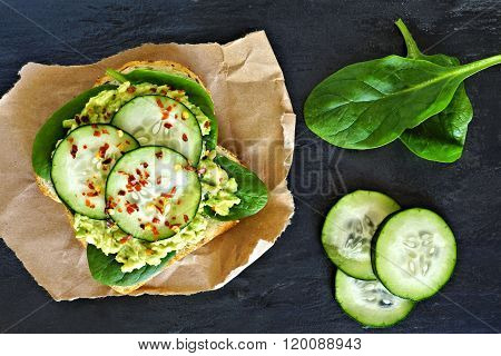 Avocado toast with cucumber, spinach and whole grain bread