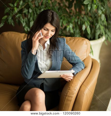 Beautiful Business Woman. Telephone Conversation Concerning The Contract.