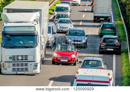 cars and trucks stuck in traffic