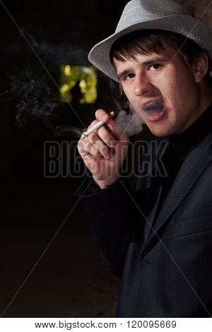 Smoking Man In A Hat