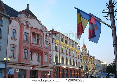 ORADEA, ROMANIA - AUGUST 01, 2015: elegant buildings and Grand Hotel Astoria, Art Nouveau and Viennese Secession architecture, in Ferdinand Square of Oradea at evening.