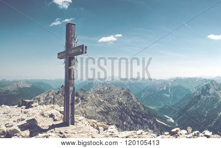 Panoramic of Summit Cross on Mountain Peek in Allgau Alps on Sunny Day with Blue Sky and View of Mountain Ranges in Distance, near Germany-Austria Border