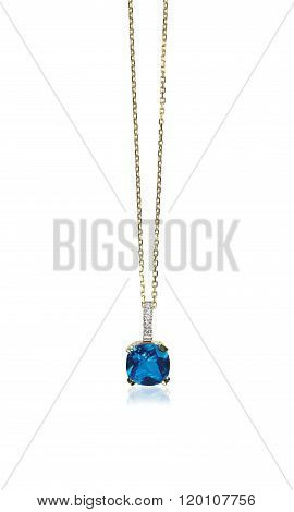 Blue sapphire gemstone birthstone necklace with diamonds isolated on white. Cushion cut stone