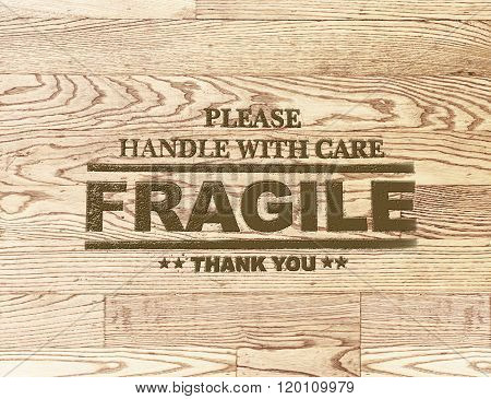 Fragile Word Stamp On Wood Plank Background