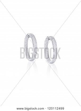 Pave Diamond Hoop Earrings isolated on white with a reflection