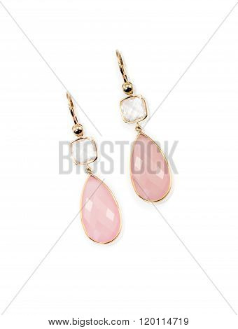 Pair of pink rose quarts dangle elegant earrings isolated on white with a description