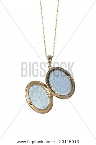 Empty gold vintage locket on a chain open