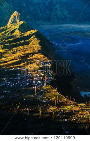 Village near cliff at Bromo Volcano in Tengger Semeru national park Java Indonesia