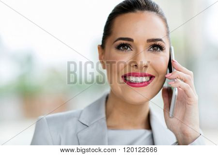 portrait of gorgeous young office worker making phone call