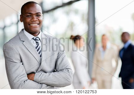 handsome black businessman executive looking at the camera