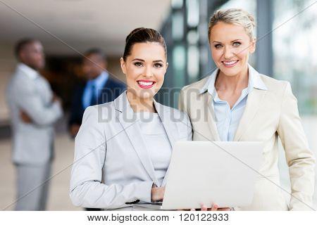 beautiful businesswomen using laptop in office