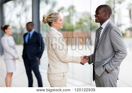 professional business people handshaking in modern office