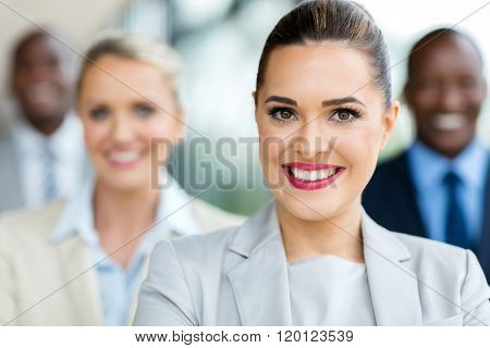 closeup portrait of elegant businesswoman with team on background