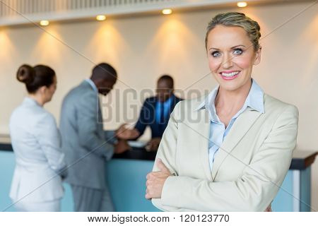 beautiful bank manager with customers on background