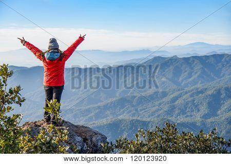 Woman Traveler On Peak Of Mountain