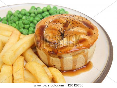 Meat pie with chips, peas and gravy