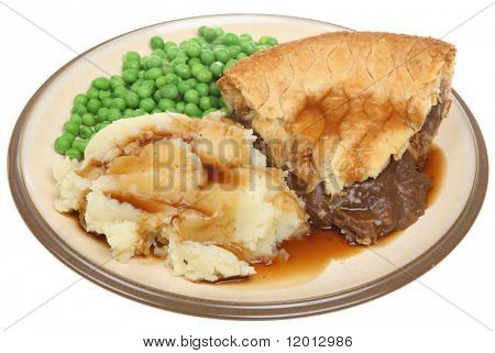 Steak pie with mashed potato, peas and gravy.