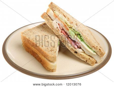 Triple sandwich with chicken, bacon and cheese
