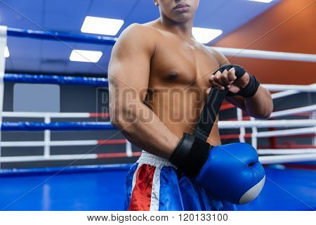 Cropped image of a boxer getting ready for fight