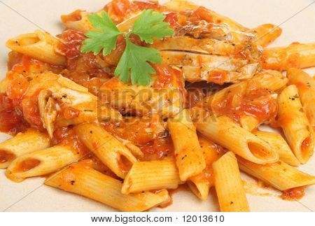 Penne pasta with chicken in arrabiata sauce