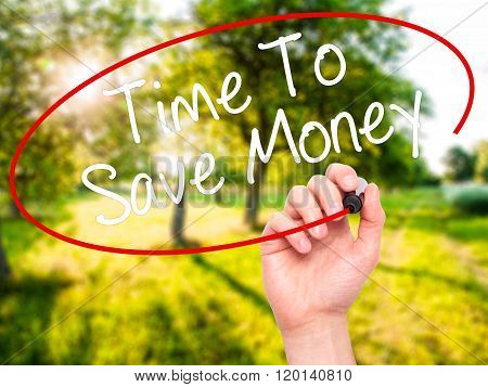 Man Hand Writing Time To Save Money  With Black Marker On Visual Screen.