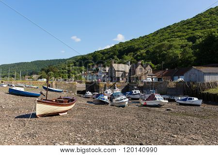 Porlock Weir Somerset England UK near Exmoor Heritage with boats at low tide in summer