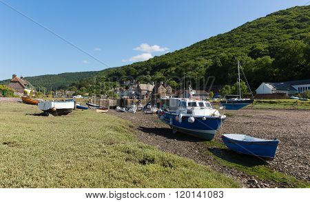 Porlock Weir Somerset England UK near Exmoor Heritage with boats at low tide in summer poster